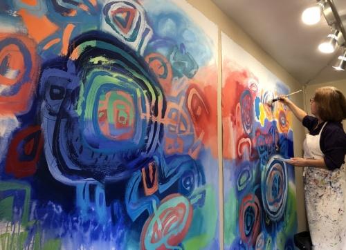 Jacqueline Unanue in studio while painting her series Gaiamama