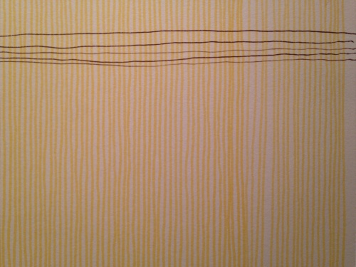 yellow drawing with bamboo pen