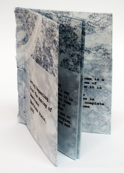 small artist book, black text on blue background, Loving Repeating by Bill Brookover